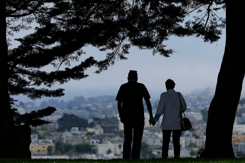 couple under a tree holding hands